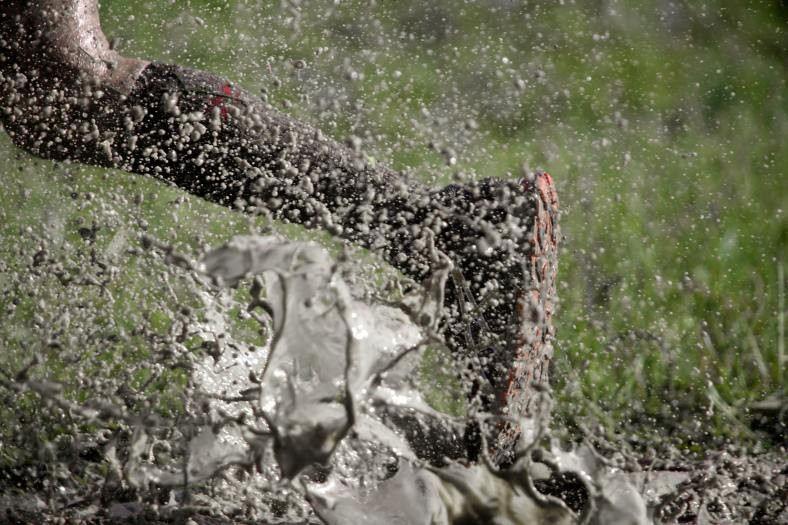 person running through the mud